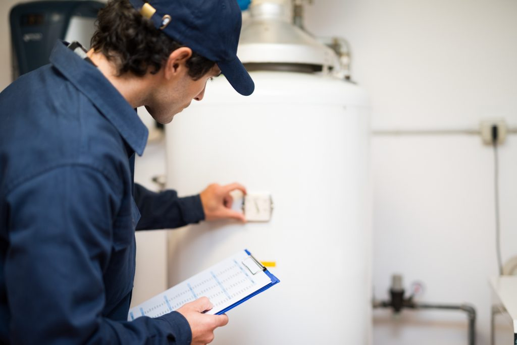 boiler maintenance and repair on hot-water heater.