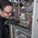 Furnace home inspection by Aire One technician.